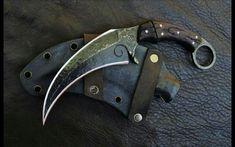 Hand forged karambit. Leather sheath. Wood handle