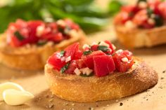 Picture of Fresh homemade crispy Italian antipasto called Bruschetta topped with tomato, garlic and basil on wooden board (Selective Focus, Focus on the front of the middle bruschetta) stock photo, images and stock photography. Bruschetta Recept, Bruschetta Bread, Tomato Bruschetta, Shrimp Bruschetta, Best Party Appetizers, Appetizer Recipes, Thanksgiving Appetizers, Healthy Finger Foods, Healthy Food