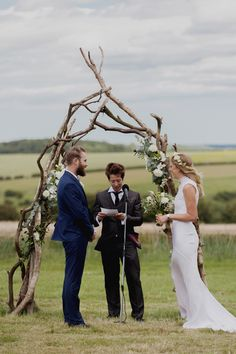 Weathered wooden ceremony arch for Zoe and Alex's rustic hippy outdoor wedding with a barefoot bride in a boho wedding dress // Photography: Mariell Amelie // The Natural Wedding Company