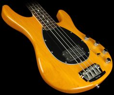 ernie ball music man - sterling bass transparent gold with matching headstock.