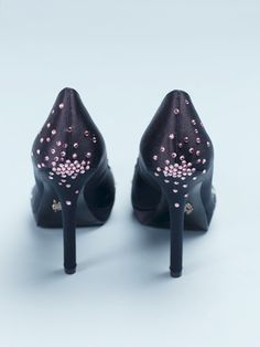DIY -Embellished Heels Showing that you'll need smaller gems/decorations for less flat surfaces on the shoe