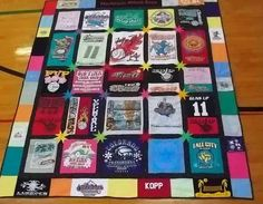 Graduation Tee Shirt Quilt, Volleyball, Sports, Custom Made  I like using the t-shirts as the border..not the starbursts, though