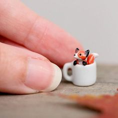 Tiny fox. In mug. Because of reasons. (OOAK for now, might sculpt more of these in the future)