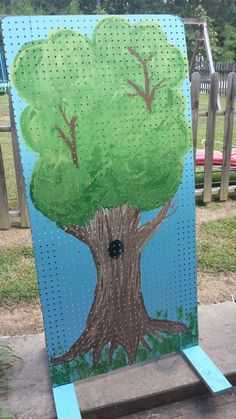 School carnival game. Paint a tree on peg board attached to frame. Paint a tree. Holes are perfect to hold dum - dum suckers. Paint black on the bottom of a few sucker sticks and scatter them on the tree. Add the rest of the suckers to fill in. Kids get to pick a sucker and if it has a black stick they win a prize.