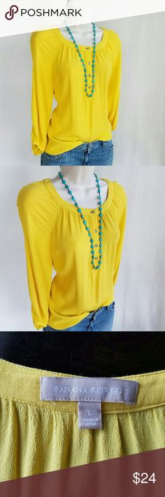 Banana Republic sunflower top Sunflower yellow three-quarter sleeve scoop neck pop over top with silver tone buttons on yoke and cuffs.  Has a couple small / not noticeable thread pulls.  Flowy and easy to wear. Banana Republic Tops