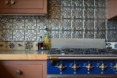 Photo by Sarah Greenman - pressed tin back splash, royal blue Lacanche range #home #decor