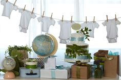 Map-Themed Baby Shower. Using vintage maps, globes and suitcases can set a worldly stage for a travel-inspired baby shower.