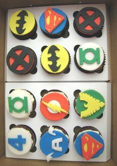 Superhero Cupcakes! Batman, Superman, X-Men, Green Lantern, The Flash, Fantastic Four, Captain America, and Phoenix.