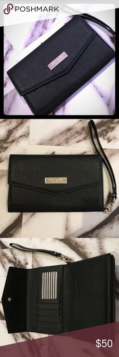 """Black Kate Spade Portable Tech Wristlet Black leatherette portable tech Wristlet that fits the iPhone 6+ and smaller tech devices. Button closure with Kate Spade solid gold plated nameplate. Gold details. Interior included the popular black and white striped decor with 5 card slots and two late pockets. Dimensions: (open) 10.25"""" L 6.75"""" W. kate spade Bags Clutches & Wristlets"""