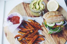 Falafel Burger with Spicy Sweet Potato Fries and Avocado Hummus