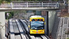 On August the world's longest guided bus line, the O-Bahn, opened in Adelaide, Australia. Time In Australia, South Australia, Civil Engineering Projects, Melbourne, Sydney, Bus System, Bus Terminal, Bus Coach, August 20