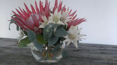 King protea and flannel flower arrangement in fishbowl vase by RANE flowers