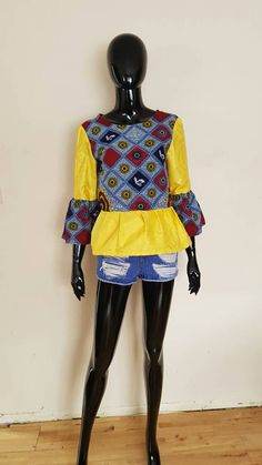 Check out this item in my Etsy shop https://www.etsy.com/uk/listing/513976671/peplum-top-bell-sleeve-top-ankara-blouse