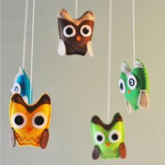 Hanging Owl Baby Mobile - Blue, Green, Lime Green, Yellow, Brown - As featured in PREGNANCY and NEWBORN MAGAZINE. $40.00, via Etsy.