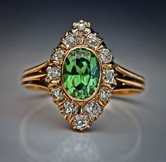 circa 1890 A Russian marquise shaped antique  ring:  bezel-set with an oval 1.61 ct demantoid garnet of exceptional brilliance.  The demantoid is