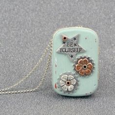 A recycled tin becomes a locket that's part vintage, part steampunk, and all charm! Best yet, a secret music box inside plays a lovely tune!