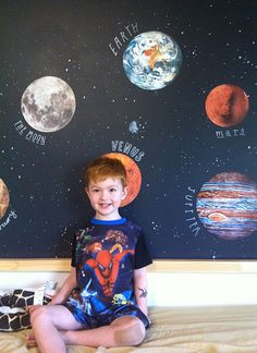Planet cutouts and hand-drawn stars make for a little boy's room that's out of this world.   Design*Sponge