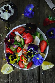 Edible Flowers, Food Photography Challenge-Caesar Salad to a whole other level. I add grilled chicken, red peppers, Eng. Cucumber and sweet strawberries, shaved parm cheese. Dressed it up with my favorite homemade dressing: lemon, olive oil, pinch of kosher salt and voila. Garnished it with stunningly beautiful Pansies.