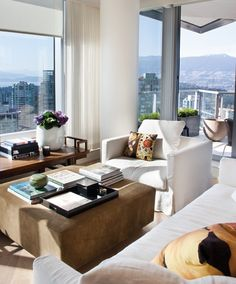 Love this living room layout when dealing with floor to ceiling windows