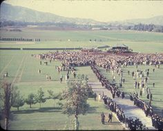This is an image of the first graduation at San Fernando Valley State College (SFVSC, now CSUN) on June 12, 1959. Ninety students received their degrees on the SFVSC football field. This image shows the large expanse of empty land held by the college at this time; visible in the background is the Santa Susana mountain range. CSUN University Digital Archives.
