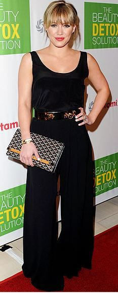 Who madee Hillary Duff's black tank top, wide pants, clutch and jewelry that she wore in Los Angeles?