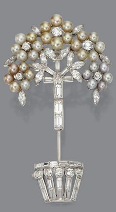 NATURAL PEARL AND DIAMOND JABOT PIN, CIRCA 1930 The topiary motif decorated with clusters of small natural pearls in natural colors including light yellow and light gray, further decorated with 50 round, marquise-shaped, baguette and shield-shaped diamonds weighing a total of approximately 8.50 carats, mounted in platinum.