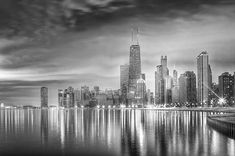Chicago Reflections BW by Lindley Johnson. Early in the morning, the beautiful city of Chicago is reflected in the waters of Lake Michigan.  This is one of my favorite black and white images in my Fine Art America gallery.