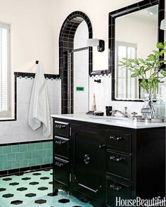 A black vanity topped with honed Calacatta Luna marble anchors the boy's bathroom. Glass pulls and knobs by House of Antique Hardware. Porcher's Mesa sink and THG faucets. - April 13 2019 at Boys Bathroom, Retro Bathrooms, Vintage Bathrooms, Bold Tile, Bathroom Colors, Bathrooms Remodel, Bathroom Design, Black Bathroom, Black Vanity Bathroom