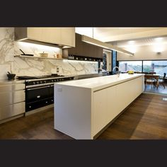 The kitchen's industrial elements and residential styling combine to achieve a cohesive whole.