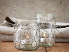 Simple sleeves of chicken wire to slip on and off glass jars - I guess you could call them jar cozies too.