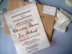 Wedding invitation-invitation printed on vellum and sewn to vintage papers