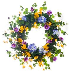 This grapevine base is accented brilliantly with blue and purple hydrangea, forsythia, purple pansies, and ivy. $129