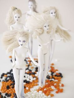 "barbies spray-painted white make downright frightening decorations. (called ""dolls of the living dead"")"