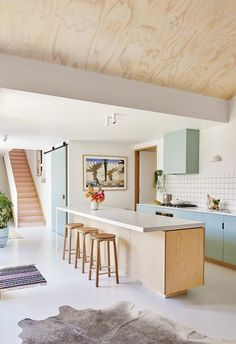 Interior stylist Emma O'Meara's colourful home with bold ideas Charming kitchen that mixes white with plywood and pops of pastel pink and pastel blue. White kitchen island and timber stools. White Kitchen Island, White Kitchen Cabinets, Kitchen Island Stools, Maple Cabinets, Blue Cabinets, Kitchen Islands, Regal Design, Küchen Design, Design Ideas