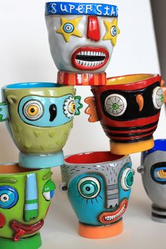 Fun cups, possible clay project... crazy faces Kris this would make a good kid project!