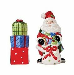 "Fitz and Floyd Be Merry Santa Salt and Pepper Set | 29-364 by Fitz and Floyd. $14.99. Copy Right:  2012. Material:  Earthenware. Care:  Hand Wash (Not dishwasher or microwave safe). Approximate Size:  2.5"" x 2"" x 4.5"". Fitz and Floyd have created this whimsical salt and pepper set to reflect a classical Christmas holiday.  The salt shaker is crafted into a Santa figurine.  He is dressed in his timeless red suit with white trimming and a hat to match.  His mittens and boots are..."