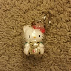 Hello Kitty Sanrio Keychain - NWOT Brand new with wrapping Price is firm. Sale - Bundle 3 keychains together for $15. Sanrio Accessories Key & Card Holders