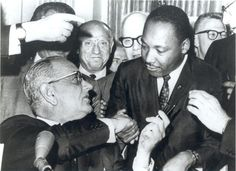 President Lyndon Johnson, left, and civil rights leader Martin Luther King Jr. shake hands at the Voting Rights Act's signing in the Capitol, Washington, August (Creative Commons) Civil Rights Bill, Civil Rights Leaders, Civil Rights Movement, Famous Pictures, Iconic Photos, Important Dates, King Jr, Martin Luther King Day, Mtv
