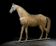 """Lexington"" Standing Horse Weathervane,    Price Realized: $ 14,950.00 American, late 19th century, molded sheet copper body, having a cast iron head with copper ears, and embossed sheet copper tail, attributed to A. L. Jewell Co., Waltham, Massachusetts. Mounted on a modern metal stand; 26.5"" high, 33"" wide.                    Condition: Old regilded surface with bullet-hole repairs."