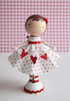 happy heart day!    lolli stands approximately 4.5 tall. her dress & garland are not removable, but her stand is. an original lollipop workshop