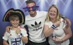 David Beckham gamely photobombs shoppers in London in a new Adidas video.