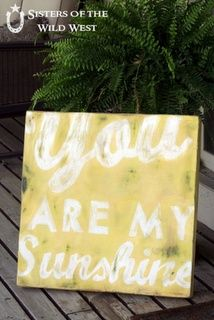 you are my sunshine sign. the white kind of fades in the yellow, but I like the font on this.