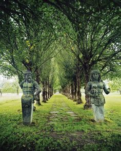 """""""Walk of the Old Gods"""". Limestone Nordic gods guard the grounds of Häringe Slott, a hotel located on a nature reserve south of Stockholm, Sweden"""""""