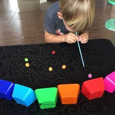 Rainbow Pompom Race Color Recognition Activity #bloggonh Rainbow Pompom race! A fun hands on matching colors game for preschoolers!