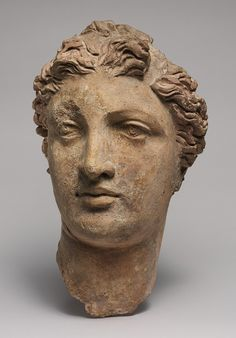 10 1/2 inches. 3rd-2nd C. BCE Greek Woman's Head, Tarentum, Southern Italy  ~ I want a planter of this! Filled with succulents that look like hair...