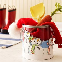 Snowman Bucket:   Create a cheery container for Christmas goodies by embellishing a clear bucket with snowmen rubber-stamped onto cardstock. If you can't find snowmen stamps, draw your own and color them in with markers.