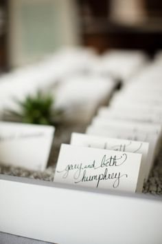 hand written seating cards in a modern display