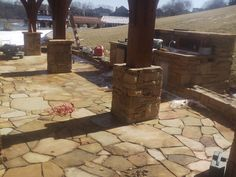 flagstone patio under construction by STONE CREATIONS