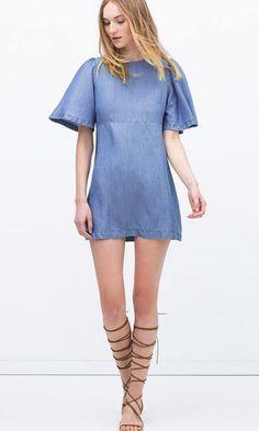 Loose cut denim dress.Frilled sleeves.