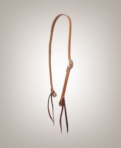 From the arena to the pasture, you will be set with this high quality Harness headstall. Latigo ties make switching bits quick and simple.  Latigo leather tie bit-ends Copper rivets – no chicago screws